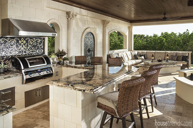 Pool pavilion houses an outdoor kitchen