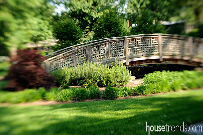 Curved bridge completes a garden design