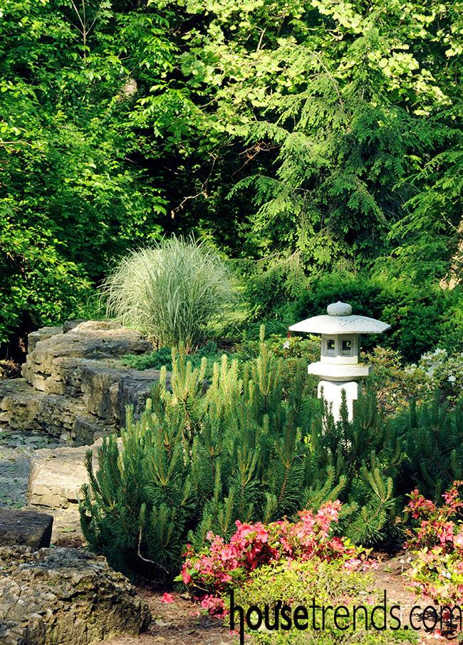 Plants help to spotlight yard art