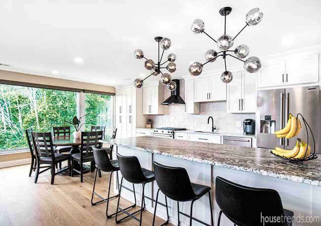 Black bar stools complete a kitchen island