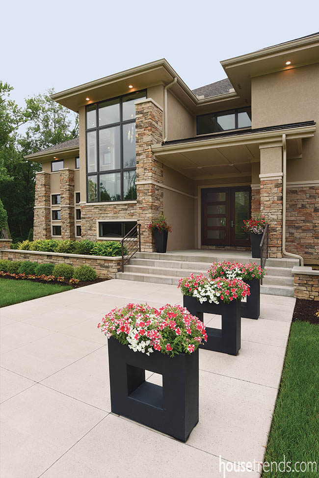 Unique planters dot walkway leading to front entry