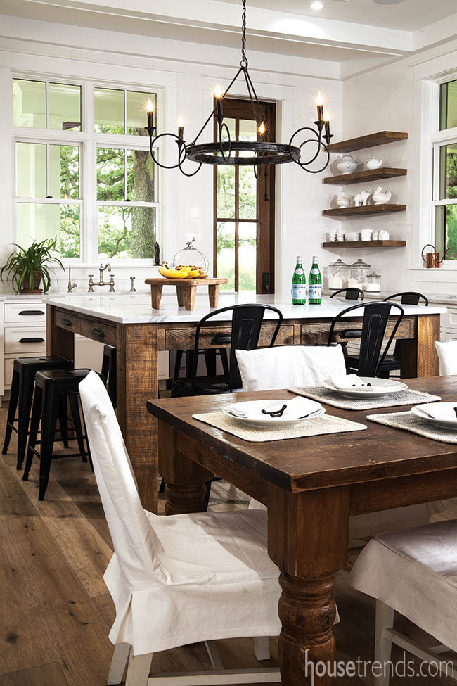 Farm table offers additional seating in a kitchen