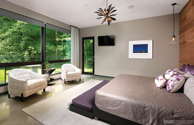 Windows add natural light to a master bedroom