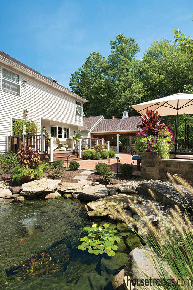 Back yard features a koi pond