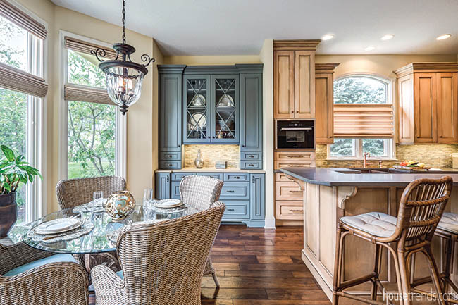 Blue china cabinet complements a remodeled kitchen