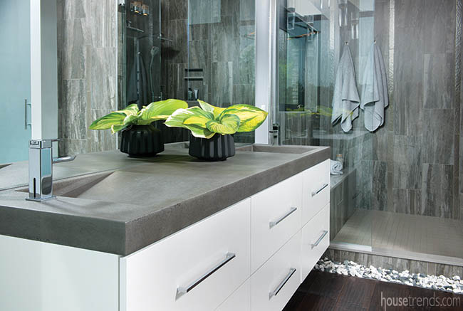 Cement countertops complete a floating vanity