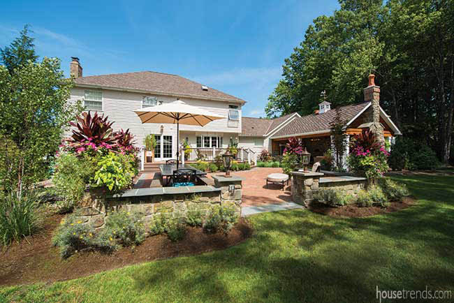 Patio leads to a lush lawn