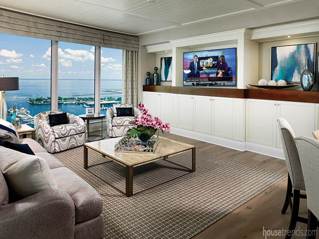 Built-in cabinetry hides a living room television