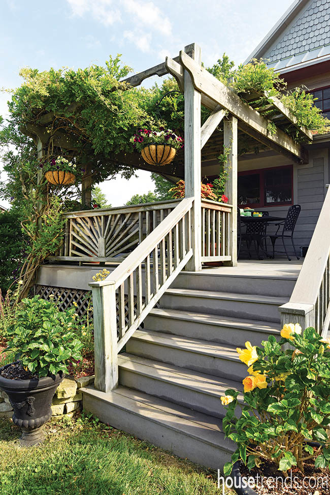 Potted plants decorate a deck