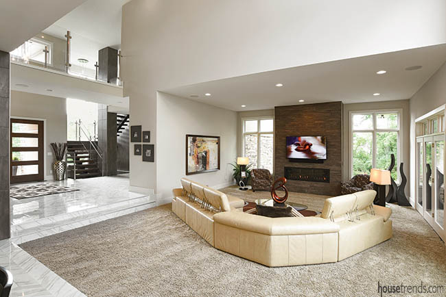 Leather sectional dominates a sunken living room