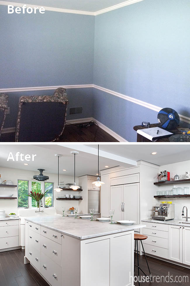 Ceiling beam blends into a white kitchen design