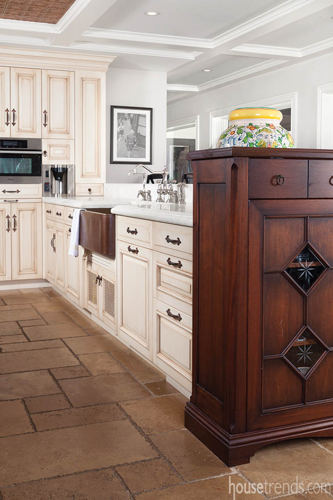 Copper sink contributes to a Tuscan kitchen design