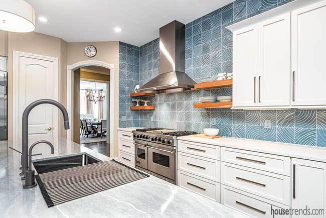 Quartz countertops complement kitchen backsplash