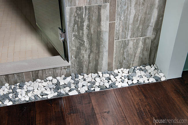 Decorative stones line a shower