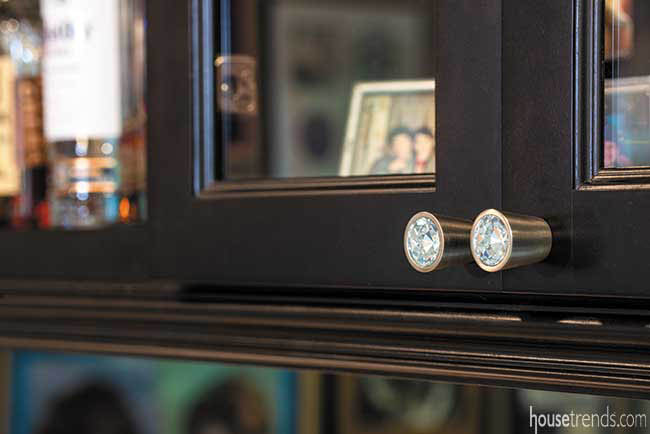 Glitzy hardware tops off bar cabinetry