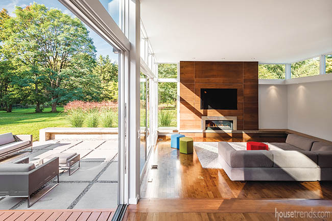Sliding doors connect two entertaining spaces