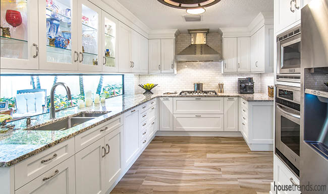Glass-front cabinets add color to a kitchen