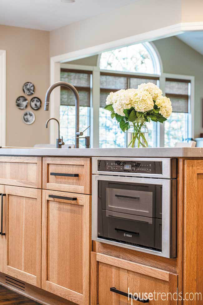 Island hosts hickory cabinets and appliances