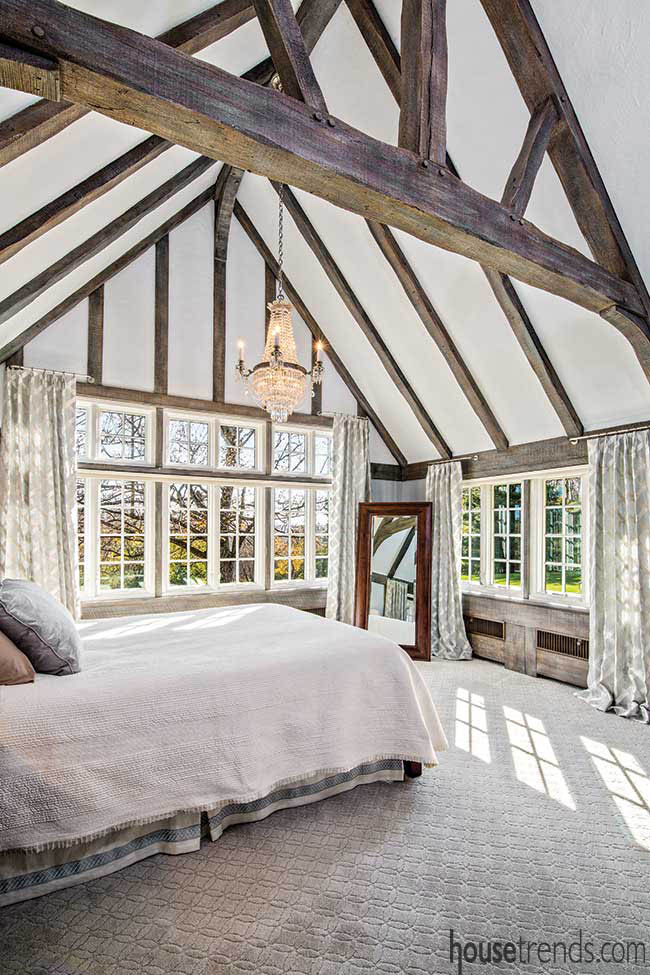 Exposed beams add interest to a master bedroom