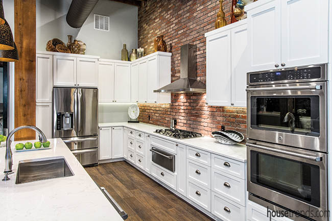 Brick backsplash complements stainless steel appliances