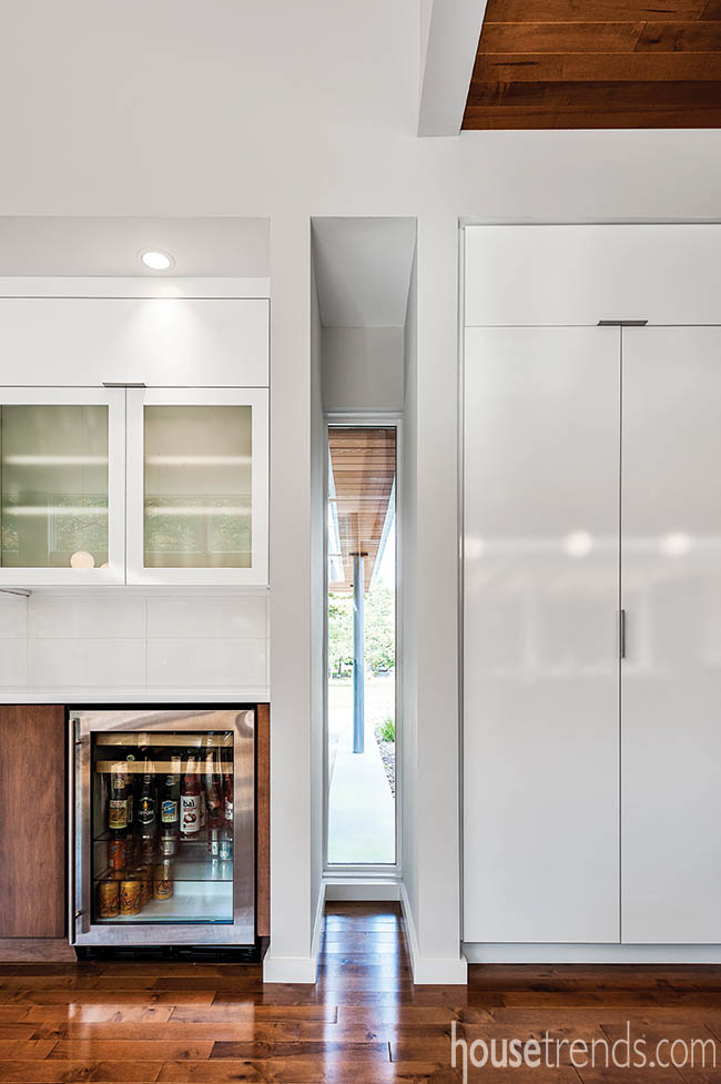 Tall white cabinets stretch to ceiling
