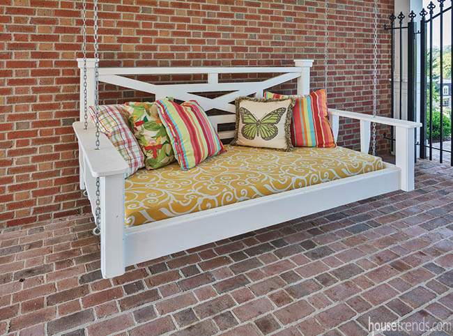 Breezeway is home to a padded porch swing