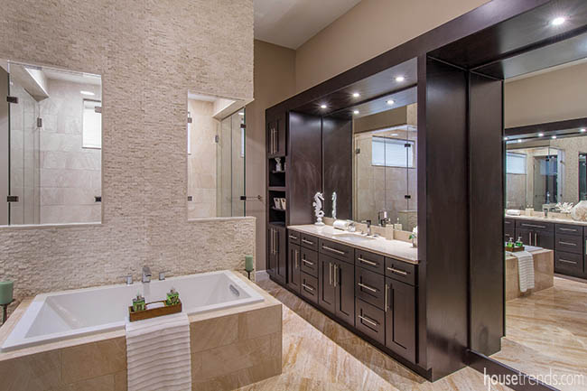 His-and-her vanities dominate a master bathroom
