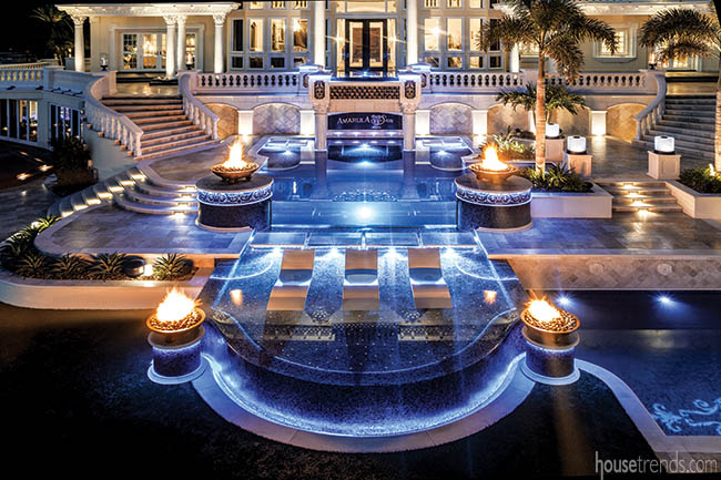 Fire bowls surround swimming pools
