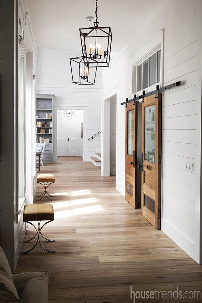 Oversized light fixtures brighten a hallway