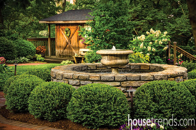 Shed adds a rustic touch to a landscape design