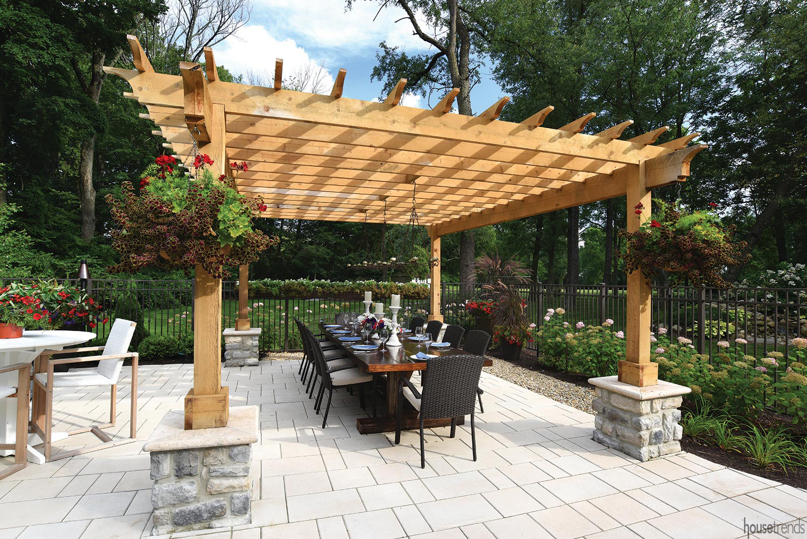 Pergola shelters an outdoor dining area