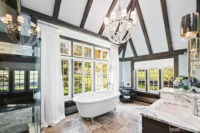 Windows lend natural light to a master bath