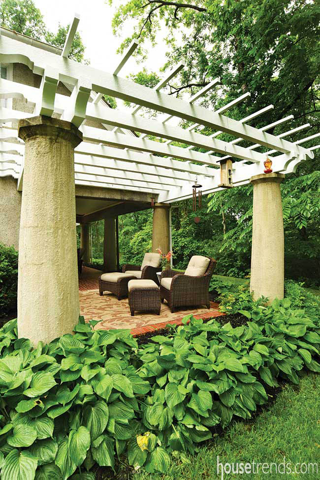 Arbor offers shade to outdoor furniture