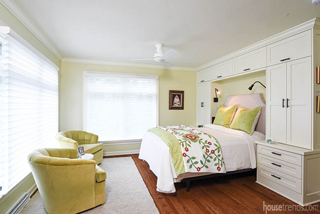 Automatic shades lighten a master bedroom