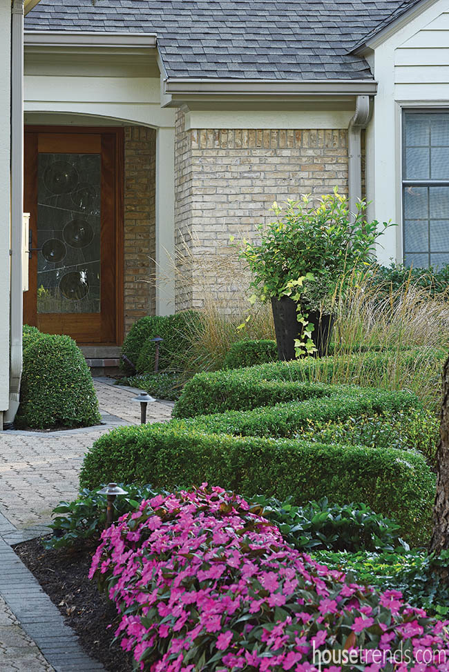 Eye-catching boxwood lines a pathway