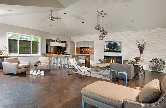 Porcelain tile floor is perfect for a pool house design