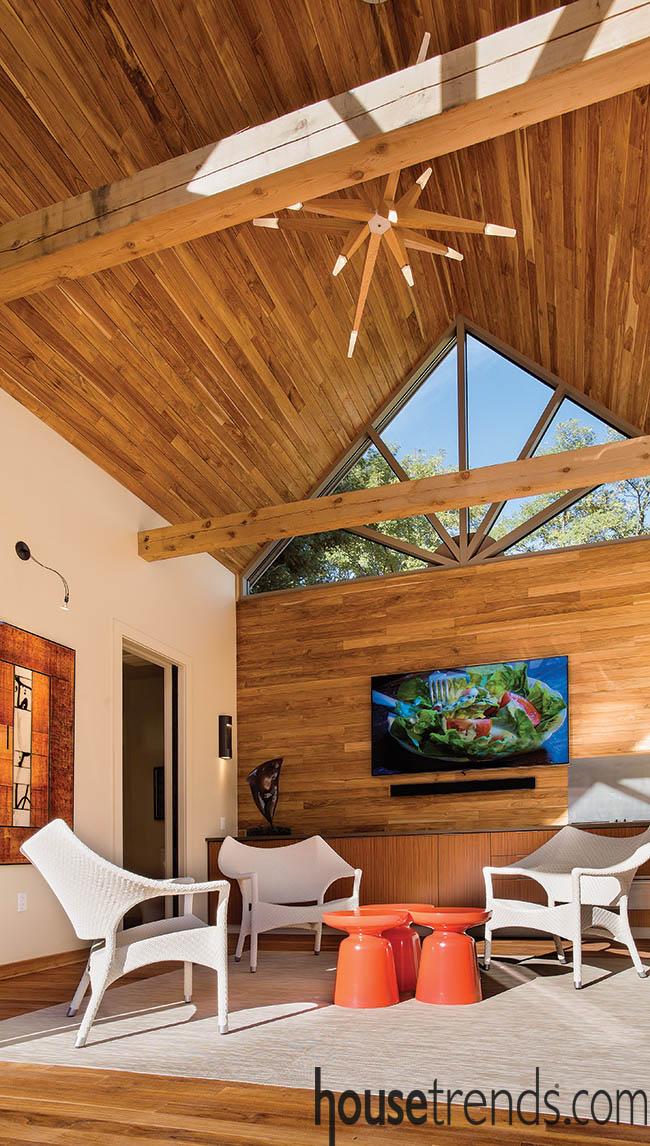 Teak planks take over a pool house design