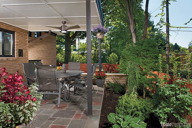 Flower beds freshen up a covered patio