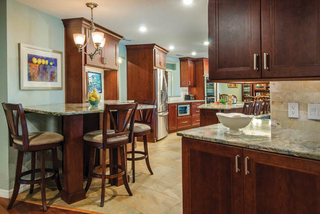 Cherry kitchen cabinets help to keep rooms connected