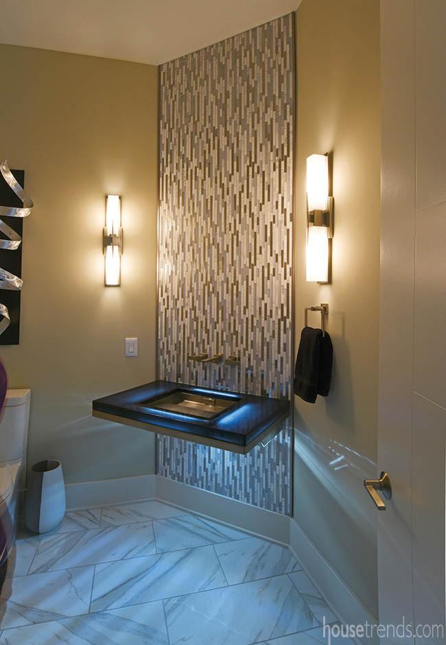 Floating vanity lights up a powder room