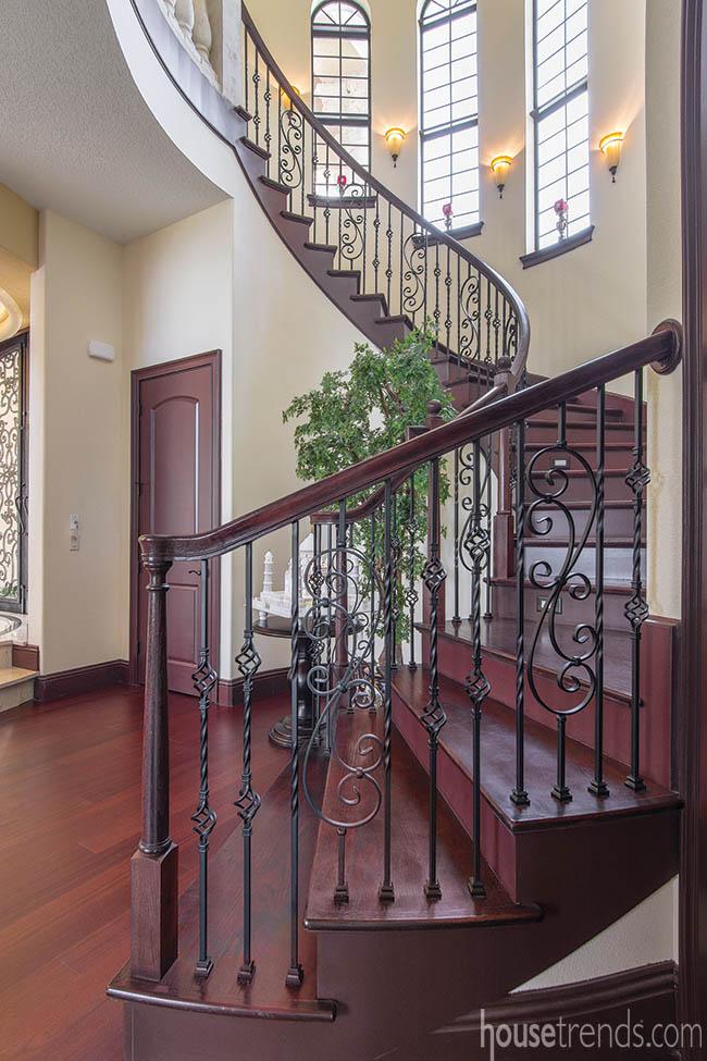 Mahogany flooring travels up a staircase