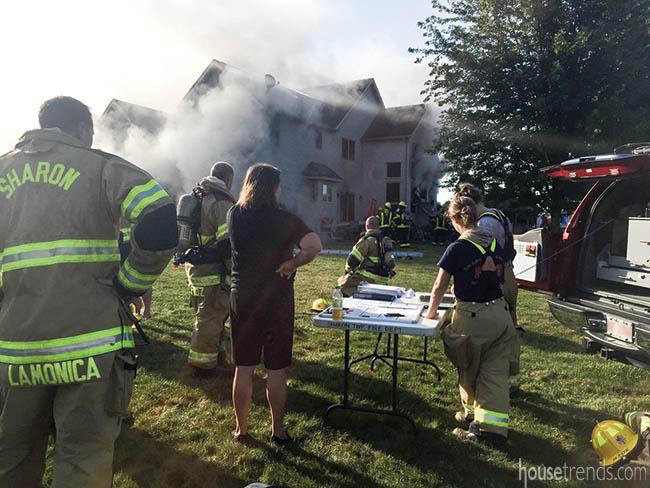 Crews battle a house fire