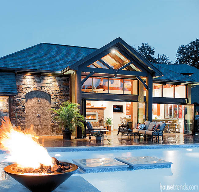Outdoor lighting adds sparkle to a pool house