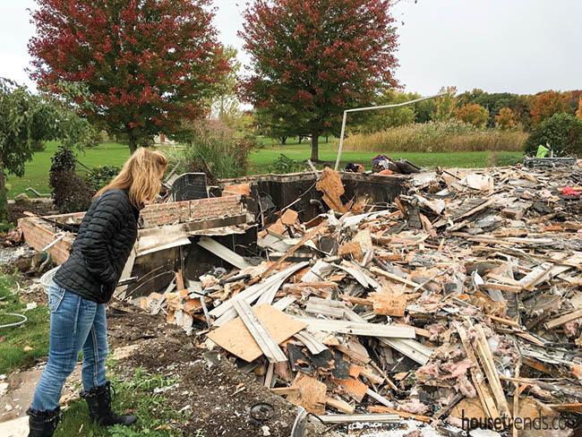 Owner peers at demolished home