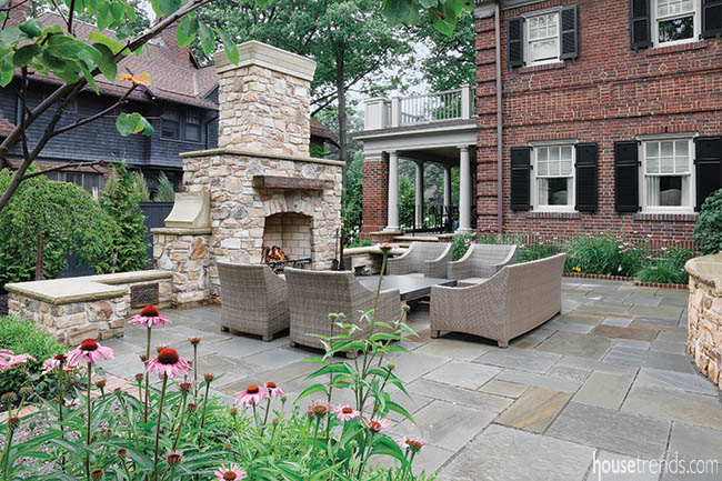 Seating beckons guests to an outdoor fireplace