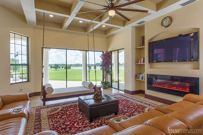 Hanging swing and oriental rug add personality to a family room