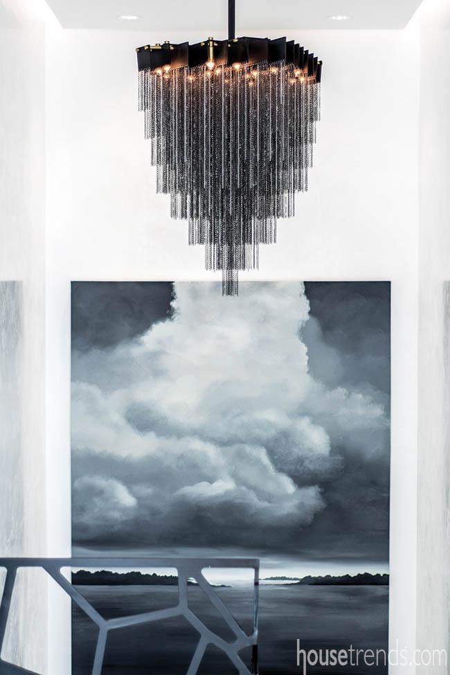 Black chandelier adds drama to a third-floor landing