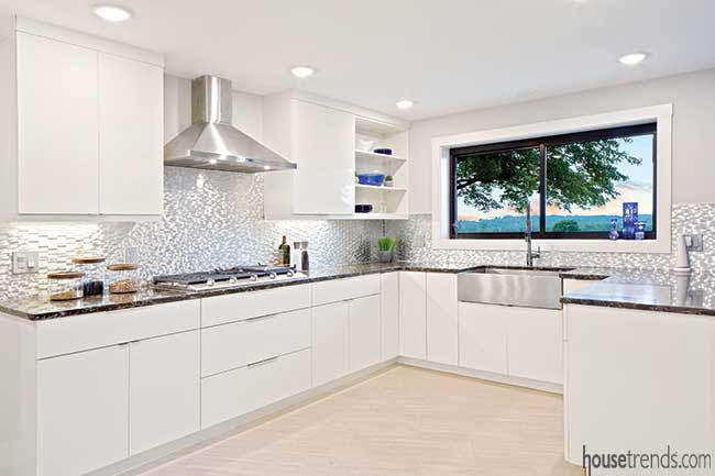 Metallic kitchen backsplash creates a modern twist
