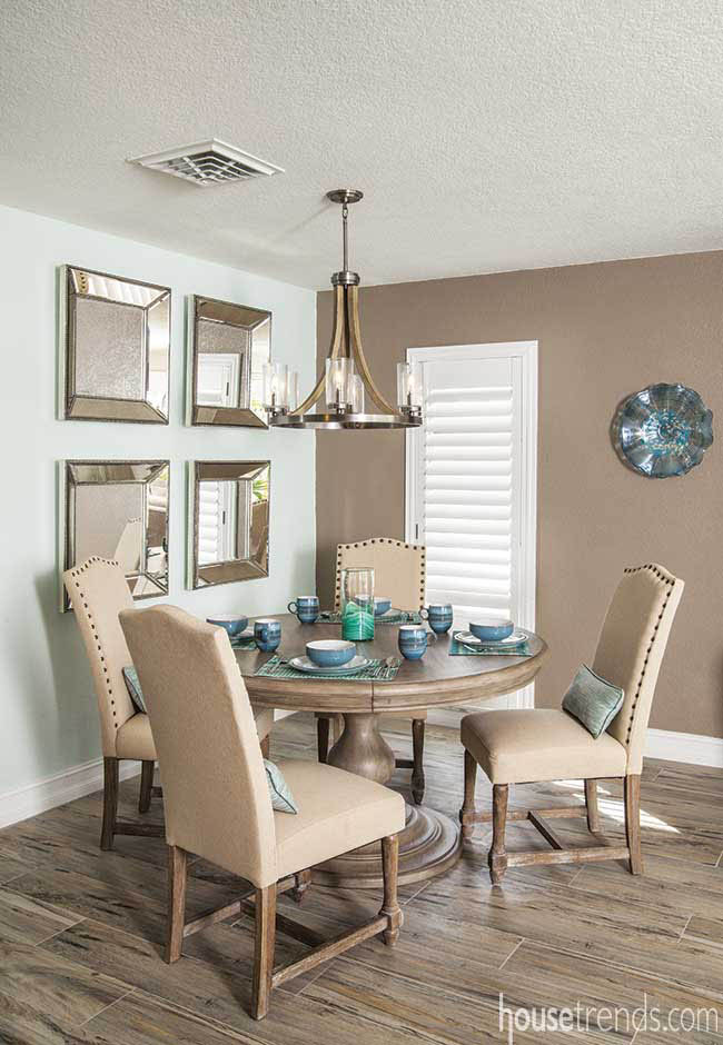 Dishes add color to a neutral breakfast nook