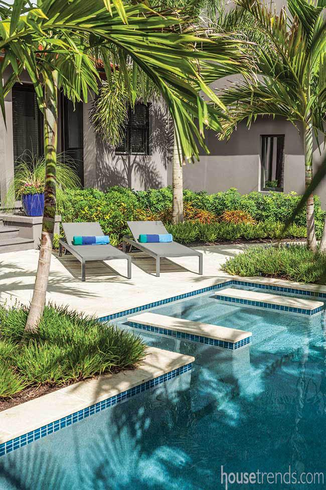 Pillars add interest to a back yard pool